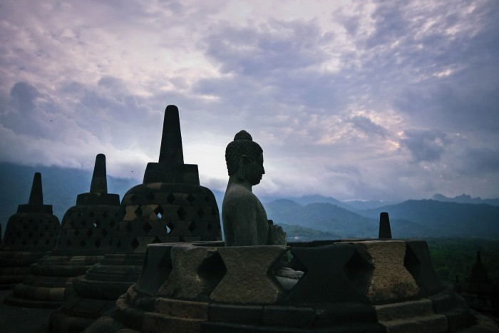 Misty morning unfolding around Candi Borobudur, Central Java This 9th century temple is surrounded by 4 volcanoes