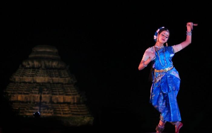 Performing at International Konark Dance festival A Bharatnatyam artist enacting in the mythical dance-drama 'Chitrangada' at ancient Konark temple, India