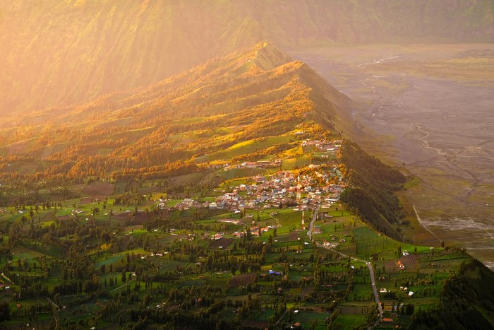 Gunung Bromo valley, East Java The valley opposite to Mount Bromo and Batok illuminated by morning rays at golden hour. Indonesia