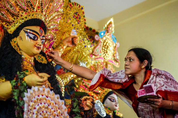 With love Goddess Durga is worshiped in Bengal as a daughter, a mother, a source of power. She is greeted with sweets and vermilion on the last day of Durga Puja festival.