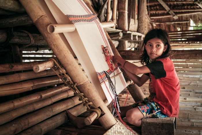 Taking baby steps towards self reliance, Indonesia Ela, 11years old indigenous girl, learnt weaving Ikkat from her mother and already mastered this art at her own home. Waingapu, Indonesia